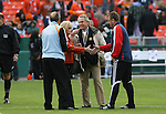 18 November 2007: Houston Dynamo owner Phil Anschutz (2nd from rt) and his wife Nancy Anschutz (2nd from lt) meet Houston head coach Dominic Kinnear (l) and New England head coach Steve Nicol (SCO) (r) before the game. The Houston Dynamo defeated the New England Revolution 2-1 at RFK Stadium in Washington, DC in MLS Cup 2007, Major League Soccer's championship game.