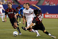 The Fire's Justin Mapp attempts to split the defense of the MetroStars' Mike Magee and Joselito Vaca. The Chicago Fire were defeated by the NY/NJ MetroStars 2-1 at Giant's Stadium, East Rutherford, NJ, on July 24, 2004.