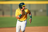 AZL Athletics Gold Yhoelnys Gonzalez (12) runs to third base during an Arizona League game against the AZL Rangers on July 15, 2019 at Hohokam Stadium in Mesa, Arizona. The AZL Athletics Gold defeated the AZL Athletics Gold 9-8 in 11 innings. (Zachary Lucy/Four Seam Images)
