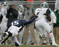 State College, PA - 11/27/2010:  LB Bani Gbadyu (15) tackles MSU ballcarrier Edwin Baker (4) from behind.  Penn State lost to Michigan State by a score of 28-22 on Senior Day at Beaver Stadium...Photo:  Joe Rokita / JoeRokita.com..Photo ©2010 Joe Rokita Photography