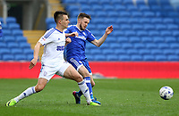 Jonas Knudsen of Ipswich Town challenges Craig Noone of Cardiff City during the Sky Bet Championship match between Cardiff City and Ipswich Town at The Cardiff City Stadium, Cardiff, Wales, UK. Saturday 18 March 2017