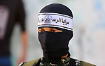 Masked militants of Great Prophet Brigades, the military wing of the Al-Sabreen movement, take part in a military parade in Deir el-Balah refugee camp in the central of Gaza Strip, on October  20, 2017. Photo by Atia Darwish