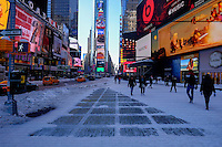 Snow is seen on the floor as people visit Times Square after the pass of the winter storm JONAS, in New York, 01/24/2016. Photo by VIEWpress
