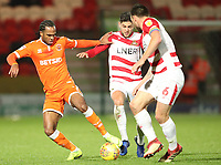 Blackpool's Nathan Delfouneso and Doncaster Rovers' Andrew Butler<br /> <br /> Photographer Rachel Holborn/CameraSport<br /> <br /> The EFL Sky Bet League One - Doncaster Rovers v Blackpool - Tuesday 27th November 2018 - Keepmoat Stadium - Doncaster<br /> <br /> World Copyright &copy; 2018 CameraSport. All rights reserved. 43 Linden Ave. Countesthorpe. Leicester. England. LE8 5PG - Tel: +44 (0) 116 277 4147 - admin@camerasport.com - www.camerasport.com