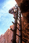 A hiker climbs a ladder and enters a whole new world at the top. Canyonlands National Park, Utah.
