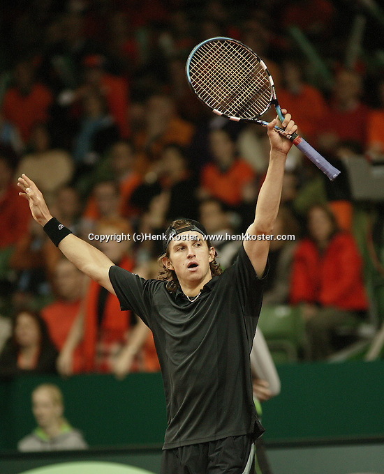 12-2-06, Netherlands, tennis, Amsterdam, Daviscup.Netherlands Russia, Igor Andreev in jubilation after defeating Jesse Huta Galung to make 0-4 for Russia