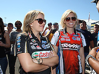 Feb. 14, 2013; Pomona, CA, USA; NHRA top fuel dragster driver Brittany Force (left) with sister Courtney Force during qualifying for the Winternationals at Auto Club Raceway at Pomona.. Mandatory Credit: Mark J. Rebilas-