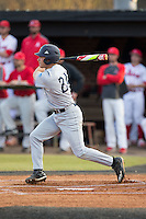Kyle Smith (24) of the Catawba Indians follows through on his swing against the against the Belmont Abbey Crusaders at Abbey Yard on February 7, 2017 in Belmont, North Carolina.  The Crusaders defeated the Indians 12-9.  (Brian Westerholt/Four Seam Images)