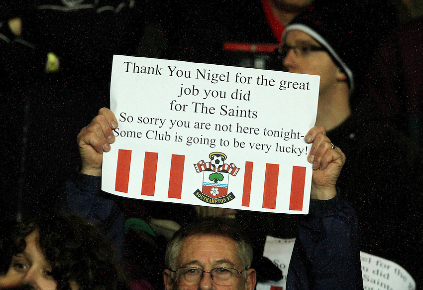 A fan holds up a message of support for Nigel Atkins...- Credit - CameraSport - James Marsh - ..Football - Barclays Premiership - Southampton v Everton - Monday 21st January 2013 - St Mary's - Southampton..