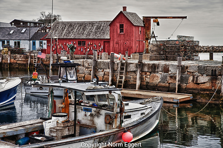 Fishing boats moored in Rockport Harbor with Motif #1 in the background.