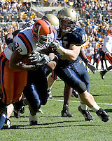 Pitt linebacker Scott McKillop (40) tackles Syracuse running back Doug Hogue (32).  The Pitt Panthers defeated the Syracuse Orange  20-17 on November 03, 2007 at Heinz Field, Pittsburgh, Pennsylvania.