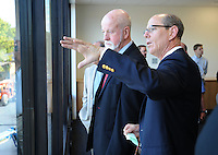 NWA Democrat-Gazette/ANDY SHUPE<br /> Peter Lane (right), president and CEO of the Walton Arts Center, speaks Tuesday, Sept. 22, 2015, with Mike Johnson, a member of the center's board of directors, during a tour of the new administrative offices being constructed as part of Fayetteville&rsquo;s $12.3 million municipal parking deck project. The arts center contributed more than $2.2 million to the project which will house administrative staff and include additional back-of-house space for the performing arts center. Visit nwadg.com/photos to see more photographs from the tour.