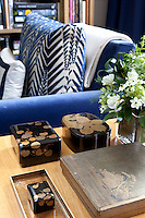 Detail of small wooden boxes on a side table in the living room