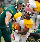 OCTOBER 4, 2014 -- D.J. Hubbard #21 of Colorado Mesa tries to outrun the reach of Cody Okray #45 of Black Hills State during their Rocky Mountain Athletic Conference game Saturday at Lyle Hare Stadium in Spearfish, S.D.  (Photo by Dick Carlson/Inertia)