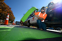 NWA Democrat-Gazette/ANDY SHUPE<br /> Marc Roberts, a highway paint marking installer for Arkansas Fence and Guardrail in North Little Rock, lays out one of several bicycle lane markings Tuesday, Nov. 5, 2019, with other crew members along Lafayette Street in Fayetteville. The city's resident-led Active Transportation Advisory Committee in June approved plans for what it calls a 5-foot-wide bicycle climbing lane, which goes in between on-street parking and the traffic lane for cars.