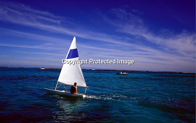 dicomau00017.Country Mauritius.A man in a sailing boat along the shore on July 4, 2003, on Mauritius. The island, located in the Indian Ocean, is a popular place for tourists. .©Per-Anders Pettersson/ iAfrika Photos.