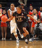 Feb. 7, 2011; Charlottesville, VA, USA; Florida State Seminoles guard Courtney Ward (12) drives down court in front of Virginia Cavaliers guard Whitny Edwards (2) during the first half of the game at the John Paul Jones Arena.  Mandatory Credit: Andrew Shurtleff-US PRESSWIRE