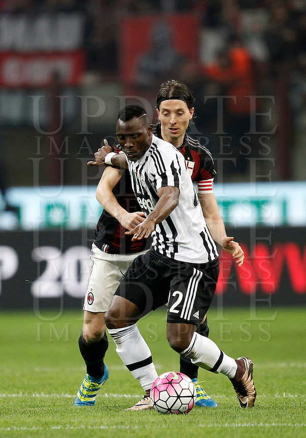 Calcio, Serie A: Milan vs Juventus. Milano, stadio San Siro, 9 aprile 2016. <br /> Juventus&rsquo; Kwadwo Asamoah, foreground, is challenged by  AC Milan&rsquo;s Riccardo Montolivo during the Italian Serie A football match between AC Milan and Juventus at Milan's San Siro stadium, 9 April 2016.<br /> UPDATE IMAGES PRESS/Isabella Bonotto