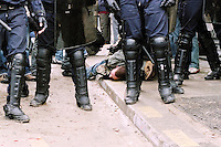 French policemen, helped by members of CRS (Republican Companies of Security) are arresting a presumed rioter during clashes at the end of a demonstration against the First Job Contract ( CPE ), Place d'Italie, Paris, France, March 28 2006...High resolution available.