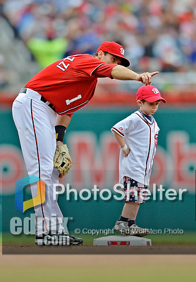 22 July 2012: Washington Nationals infielder Stephen Lombardozzi has a chat with a young fan prior to a game against the Atlanta Braves at Nationals Park in Washington, DC. The Nationals defeated the Braves 9-2 to split their 4-game weekend series. Mandatory Credit: Ed Wolfstein Photo