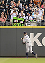 Ichiro Suzuki (Yankees),<br /> JUNE 6, 2013 - MLB :<br /> Ichiro Suzuki of the New York Yankees throws a ball to Amy Franz, a Mariners fan and &quot;Ichi-Meter&quot; inventor, during the Major League Baseball game against the Seattle Mariners at Safeco Field in Seattle, Washington, United States. (Photo by AFLO)