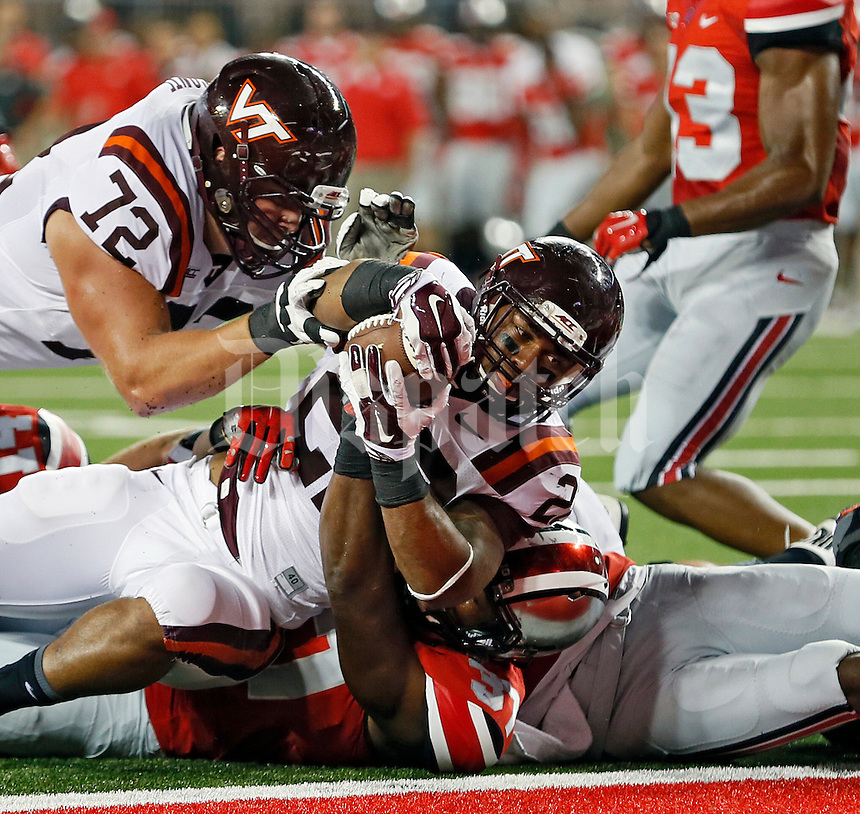 Virginia Tech Hokies running back Shai McKenzie (22) scores on a touchdown run against Ohio State Buckeyes linebacker Joshua Perry (37) during the 1st quarter of their game in Ohio Stadium on September 6, 2014.  (Dispatch photo by Kyle Robertson)