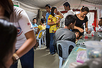 Survivors of the Zamboanga City rebel attack taking refuge in the city's largest stadium receive medical attention in the Emergency Response tent in Zamboanga, Mindanao, The Philippines on November 4, 2013. These Internally Displaced People (IDP) had taken refuge in this Barangay (neighbourhood) after surviving the 3 week long attack by MNLF rebels. Photo by Suzanne Lee for SPRINT-IPPF
