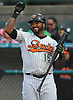Jordany Valdespin #15 of the Long Island Ducks jokingly gestures toward a teammate during the team's season home opener against the Southern Maryland Blue Crabs at Bethpage Ballpark in Central Islip, NY on Friday, May 4, 2018.