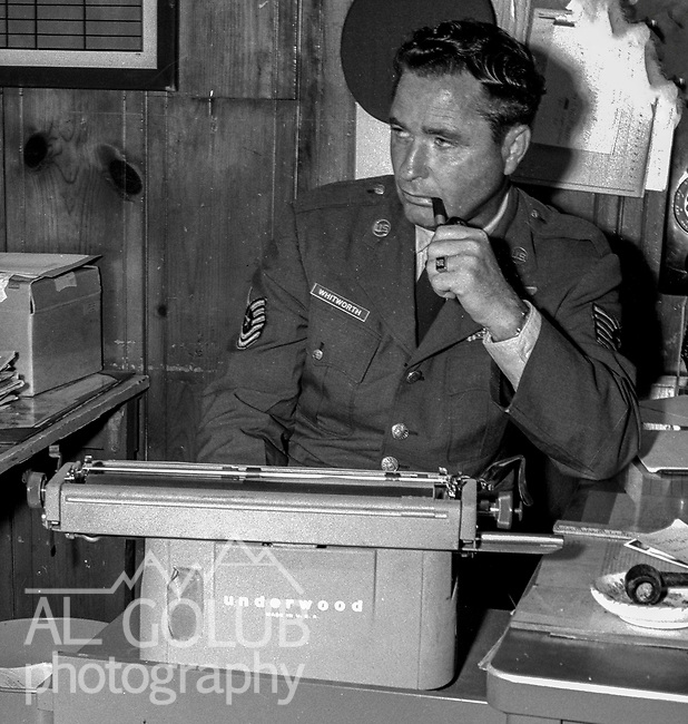 Valley Bomber Editor T/sgt Bill Whitworth.<br /> <br /> March 1964: CAFB, California<br /> Staff of the Valley Bomber, 93rd Bomb Wing, Directory of Information, SAC<br /> Photo by Al Golub/Golub Photography <br /> <br /> Castle is named for Brigadier General Frederick W. Castle, who died on Dec. 24, 1944 flying his 30th bombing mission. He died leading an armada of 2000 B-17s on a strike against German airfields. On the way to the target, an engine failure over Liege, Belgium caused his bomber to fall behind, where it was attacked by Germans and caught fire. He ordered his men to bail out but stayed alone at the controls of the flaming Flying Fortress until it crashed. The entire crew, except Gen. Castle and one airman killed before the bailout order, survived. Gen. Castle received a Medal of Honor posthumously for his bravery.<br /> <br /> Castle became home to the 93rd Bombardment Wing in 1947. Aircraft stationed at Castle included B-29, B-17 and C-54 aircraft, with B-50 bombers arriving in 1949. In 1954, B-47 bombers arrived.  On June 29, 1955, Castle received the Air Force's first B-52. These heavy bombers can hold the equivalent of three railroad cars' worth of fuel. The first Air Force KC-135 jet tanker arrived May 18, 1957<br /> <br /> Castle was selected for closure under the Defense Base Closure and Realignment Act of 1990 during Round II Base Closure Commission deliberations (BRAC 91). The last of the B-52s left the base in 1994, followed by the departure of the last of the KC-135s in early 1995. The base closed September 30, 1995.