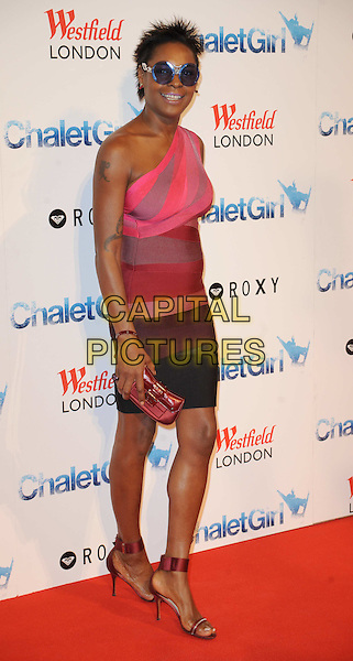 SONIQUE (Sonia Clarke).'Chalet Girl' world film premiere at Vue Westfield cinema, Shepherd's Bush, London, England 8th February 2011..full length bandage striped body con dress herve Leger red black colour block ankle strap sandals open toe clutch bag pink one shoulder tattoo blue round sunglasses glasses shades   .AP/WIZ.© Wizard/Capital Pictures.