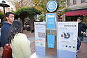 Promotional display about the electric vehicle charging stations network infrastructure that needs to be built in order to support broad adoption of electric cars and the rechargeable lithium ion battery technology used in the Nissan Leaf. Nissan Leaf Zero Emission Tour promotional event for the Nissan Leaf electric car that is scheduled to be released in Fall 2010. Car specs from Nissan: 5 person capacity, 90 MPH top speed, lithium-ion battery, 100 mile average range per charge. Santana Row, San Jose, California, USA, 12/5/09
