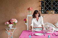 Maddalena Caruso applies the last touches to the table she has just laid