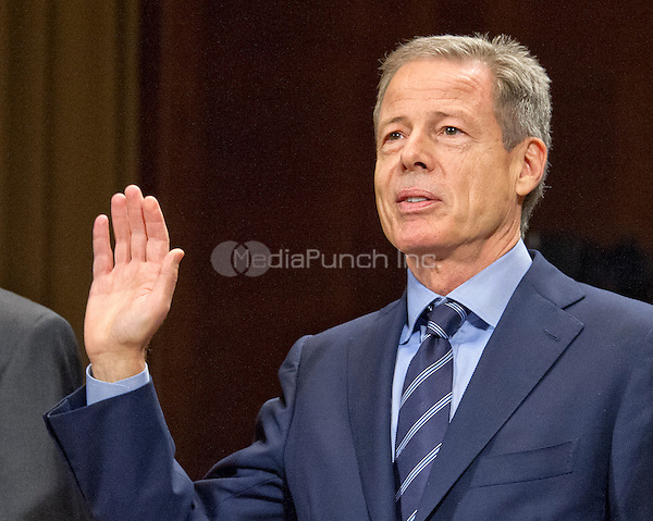 """Jeffrey Bewkes, Chairman & Chief Executive Officer,Time Warner, is sworn-in to testify before the United States Senate Committee on the Judiciary Subcommittee on Antitrust, Competition Policy & Consumer Rights hearing """"Examining the Competitive Impact of the AT&T-Time Warner Transaction"""" on Capitol Hill in Washington, DC on Wednesday, December 7, 2016.<br /> Credit: Ron Sachs / CNP /MediaPunch"""