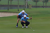 Paul Casey (Europe) on the 3rd green during the Saturday Foursomes of the Eurasia Cup at Glenmarie Golf and Country Club on the 13th January 2018.<br /> Picture:  Thos Caffrey / www.golffile.ie