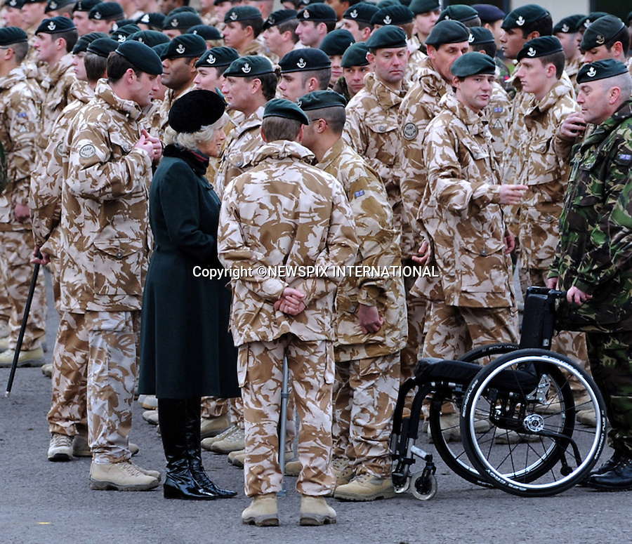 """CAMILLA, DUCHESS OF CORNWALL.presented Afghanistan campaign medals to soldiers from the 4th Battalion The Rifles, Kiwi Barracks, Bulford Camp, Salisbury, Wiltshire. .Photo Credit: ©D Harmer_Newspix International..**ALL FEES PAYABLE TO: """"NEWSPIX INTERNATIONAL""""**..PHOTO CREDIT MANDATORY!!: NEWSPIX INTERNATIONAL..IMMEDIATE CONFIRMATION OF USAGE REQUIRED:.Newspix International, 31 Chinnery Hill, Bishop's Stortford, ENGLAND CM23 3PS.Tel:+441279 324672  ; Fax: +441279656877.Mobile:  0777568 1153.e-mail: info@newspixinternational.co.uk."""