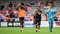 Lincoln City's John Akinde, left, Lincoln City manager Danny Cowley, centre, and Lincoln City's Josh Vickers applauds the fans at the final whistle<br /> <br /> Photographer Chris Vaughan/CameraSport<br /> <br /> The EFL Sky Bet League Two - Lincoln City v Swindon Town - Saturday 11th August 2018 - Sincil Bank - Lincoln<br /> <br /> World Copyright &copy; 2018 CameraSport. All rights reserved. 43 Linden Ave. Countesthorpe. Leicester. England. LE8 5PG - Tel: +44 (0) 116 277 4147 - admin@camerasport.com - www.camerasport.com