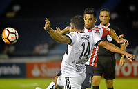 BARRANQUILLA - COLOMBIA - 08 - 02 - 2018: Teofilo Gutierrez (Der.) jugador de Atletico Junior disputa el balón con Jose Leguizamon (Izq.) jugador de Olimpia, durante partido de vuelta entre Atletico Junior (Col) y Olimpia (Par), de la fase 2 por la Copa Conmebol Libertadores 2018, jugado en el estadio Metropolitano Roberto Melendez de la ciudad de Barranquilla. / Teofilo Gutierrez (R) player of Atletico Junior vies for the ball with Jose Leguizamon (L) player of Olimpia, during a match for the second leg between Atletico Junior (Col) and Olimpia (Par), of the 2nd phase for the Copa Conmebol Libertadores 2018 at the Metropolitano Roberto Melendez Stadium in Barranquilla city, Photo: VizzorImage  / Alfonso Cervantes / Cont.