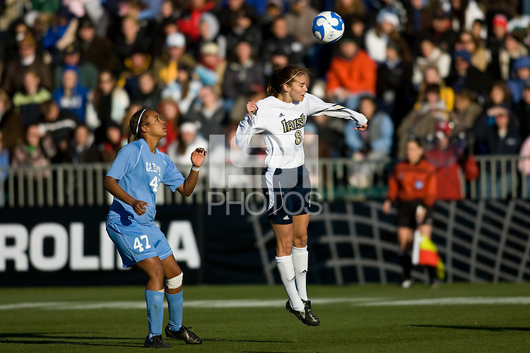 Notre Dame Fighting Irish defender Haley Ford (8) heads the ball. The North Carolina Tar Heels defeated the Notre Dame Fighting Irish 2-1 during the finals of the NCAA Women's College Cup at Wakemed Soccer Park in Cary, NC, on December 7, 2008. Photo by Howard C. Smith/isiphotos.com