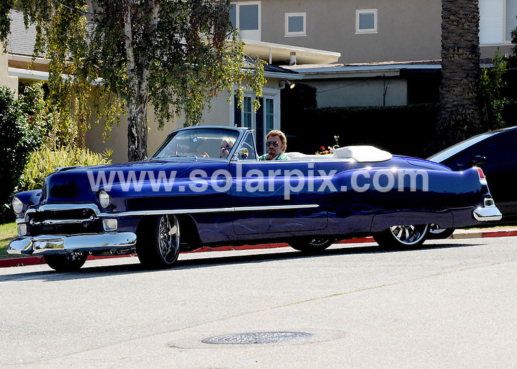 **ALL ROUND PICTURES FROM SOLARPIX.COM**.**SYNDICATION RIGHTS FOR UK AND SPAIN ONLY**.French Rock superstar, Johnny Hallyday and his wife laeticia pick up thier daughter Jade from school in the Pacific Palicades in La . Johnny is driving his very impressive classic car..This pic: Johnny Hallyday..JOB REF:12075         STL        DATE:10.09.2010.**MUST CREDIT SOLARPIX.COM OR DOUBLE FEE WILL BE CHARGED**.**MUST NOTIFY SOLARPIX OF ONLINE USAGE**.**CALL US ON: +34 952 811 768 or LOW RATE FROM UK 0844 617 7637**