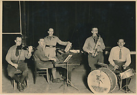 BNPS.co.uk (01202 558833)<br /> Pic: Warwick&Warwick/BNPS<br /> <br /> The Colditz POW band put on concerts for fellow allied troops<br /> <br /> A remarkable archive of photos which provide a glimpse inside the infamous Colditz Castle has come to light.<br /> <br /> The photos show the ingenuity of the Allied POWs who devised ever-bolder ways to escape from the German stronghold during World War Two.<br /> <br /> One image is of a dummy they would hold up to trick the German guards into believing the escaper was still with them during parade head counts. Others reveal the tunnels which were dug using tools smuggled into the 11th century castle in care parcels.<br /> <br /> The photos were taken by the official Colditz photographer Johannes Lange, who was employed by the German Army to take pictures of failed Allied escape attempts. They were then distributed to other POW camps to alert the guards to the methods the inmates were using in their bids for freedom.<br /> <br /> The archive is being sold by a private collector with auctioneer Warwick & Warwick, with an estimate of £1,750.