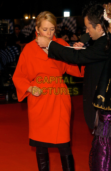 "EDITH BOWMAN.""The Prestige"" UK film premiere.Odeon West End cinema, Leicester Square.5th November 2006 London, England.Ref: CAN.half length red coat blowing funny hand arm.www.capitalpictures.com.sales@capitalpictures.com.©Phil Loftus/Capital Pictures"