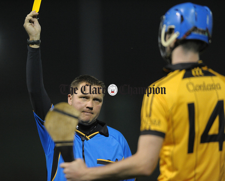 Referee Rory Hickey shows his yellow card to Clonlara's Darach Honan during their Clare Champion Cup game at Gurteen. Photograph by John Kelly.