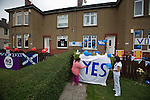 Pro-Scottish independence supporters Karen Clarkson (left) and Ann Shields attaching a 'Yes' banner in the front of their house in Cardonald, Glasgow on the day of the independence referendum. Yes Scotland were campaigning for the country to leave the United Kingdom, whilst Better Together were campaigning for Scotland to remain in the UK. On the 18th of September 2014, the people of Scotland voted in a referendum to decide whether the country's union with England should continue or Scotland should become an independent nation once again and leave the United Kingdom.
