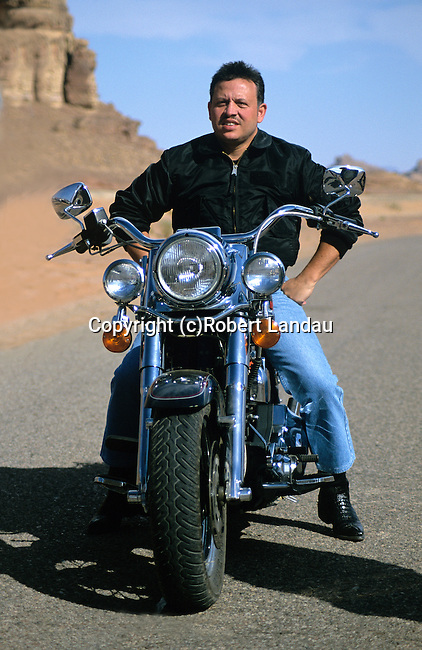 King Abdullah II of Jordan on motorcycle  in Wadi Rum