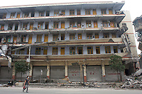 People pass by the damaged buildings in Dujiangyan, Sichuan, China. The earthquake happened at 14:28pm on 12 May 2008, with the epicenter in Wenchuan County, about 159km NW of Chengdu, Sichuan, China..17 May 2008
