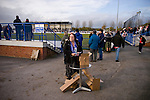 Curzon Ashton v Exeter City, 08/11/2008. FA Cup first round, Tameside Stadium. A programme seller on duty before Curzon Ashton's FA Cup first round tie Tameside Stadium, Ashton-under-Lyne against Exeter City. The home team, who play in the Unibond first division north won the match 3-2 against their opponents from Coca Cola League 2, four divisions above Curzon Ashton. It was the home side's first-ever appearance in the FA Cup proper and their reward for winning the match was an away tie at Conference team Kidderminster Harriers. Photo by Colin McPherson.