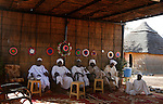 Men are seen in Klaimendo village in North Darfur, 04 Dec, 2008. Despite the fact that North Darfur is believed to currently have the highest concentration of NGOs in the world, the creation of Klaimendo district and village is the work of people born and raised in the area, rather than an outside aid agency. (John D McHugh)