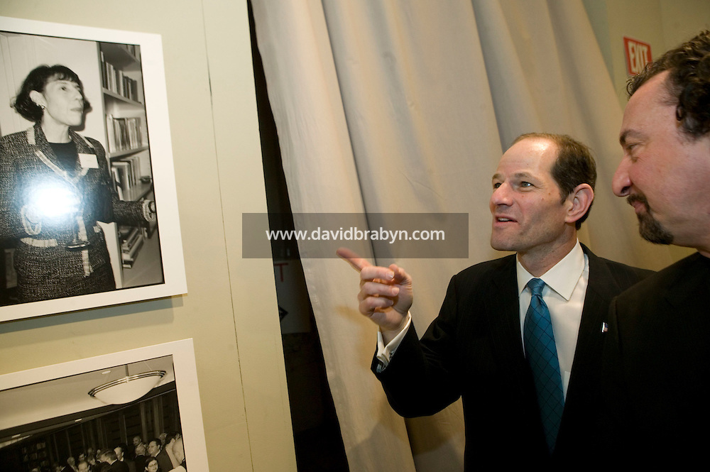 "11 January 2007 - New York City, NY - New York State Governor Eliot Spitzer (L) and photographer Marius Muresanu attend the opening of the ""Making of a Governor"" photo exhibit on his 2006 campaign at Grand Central Station in New York CIty, USA, 11 January 2007."