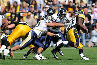 6 September 2008:  FIU linebacker Michael Dominguez (53) and linebacker Armond Willis (91) pursue Iowa running back Shonn Greene (23) in the first half of the Iowa 42-0 victory over FIU at Kinnick Field in Iowa City, Iowa.