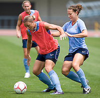 USWNT forward Abby Wambach keeps the ball away from teammate Lauren Cheney during practice at Anyang Sports Center in Seoul, South Korea.